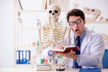 Crazy professor studying human skeleton