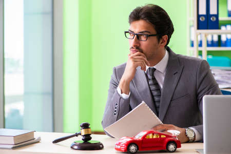 Young handsome lawyer working in the office Stock Photo