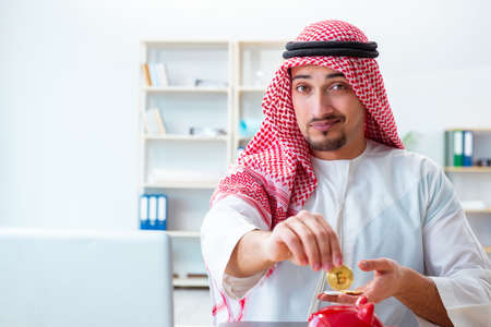 Arab man with bitcoin in cryptocurrency mining concept Stock Photo