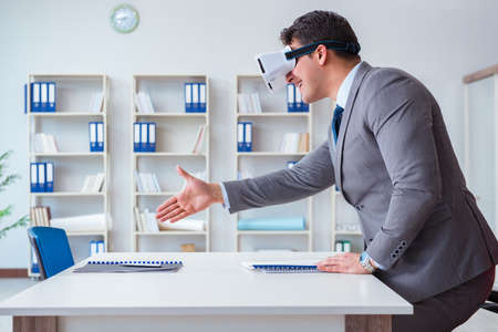 Businessman with virtual reality glasses in the office Stock Photo
