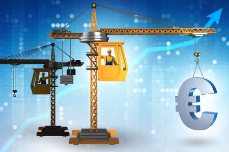 Construction crane lifting euro in currency business concept
