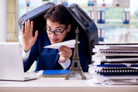 Employee thinking of vacation due to excessive workload Stock Photo