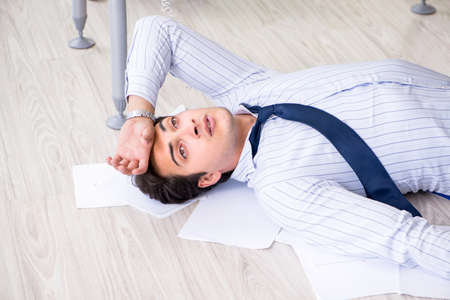 Frustrated businessman stressed from excessive work Stock Photo