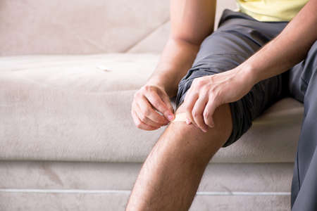Young man at home after injury Stock Photo