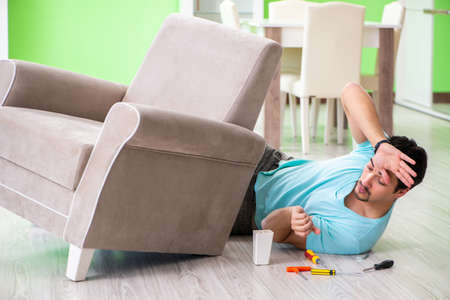 Man Repairing Furniture At Home Stock Photo, Picture And Royalty Free  Image. Image 106408335.