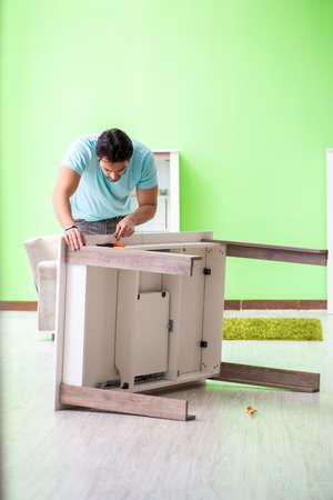 Man repairing furniture at home 스톡 콘텐츠