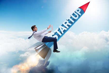 Businessman in start-up concept flying on rocket