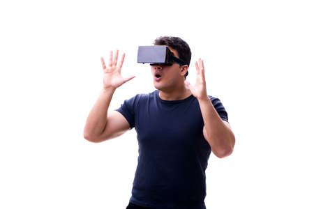 Man playing with virtual reality glasses on white background