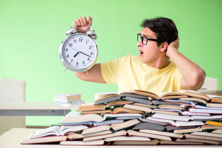 Student with too many books to read before exam