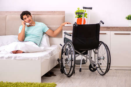 Young handsome disabled man recovering at home Stock Photo