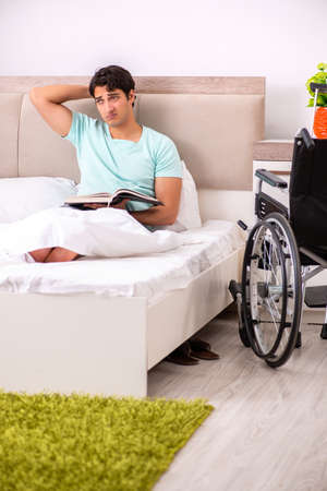 Young handsome disabled man recovering at home Stok Fotoğraf