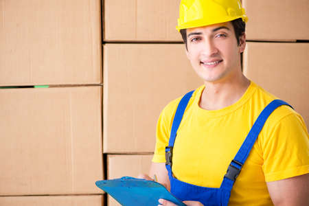 Man contractor working with boxes delivery Фото со стока