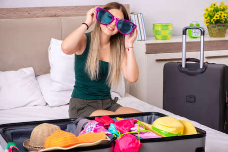 Young woman getting ready for summer vacation