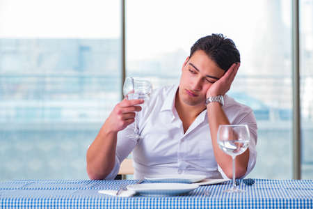 Handsome man alone in restaraunt on date Stock Photo