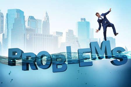 Businessman having problems in business concept Banque d'images