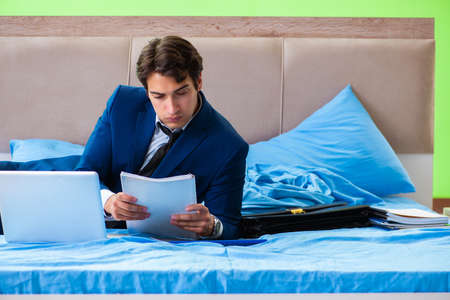 Businessman working in the hotel room Stock Photo