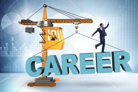 Businessman in career progression concept with crane 스톡 콘텐츠