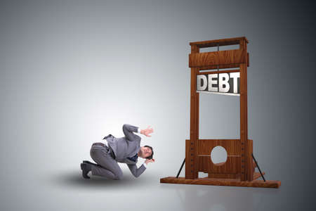 Businessman in heavy debt business concept Banque d'images