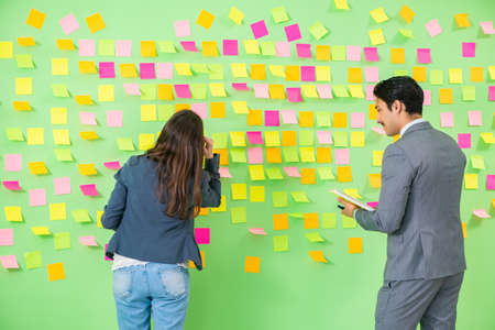 Business colleagues discussing future priorities Stock Photo