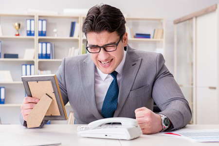 Businessman looking at the picture frame
