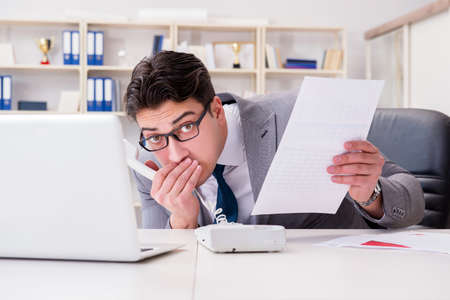 Businessman leaking confidential information over phone Stock Photo