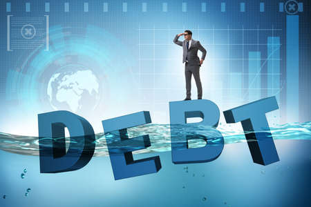 Businessman in debt business concept Stock Photo