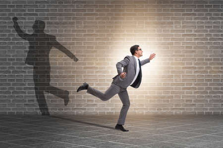 Businessman and his shadow in business concept