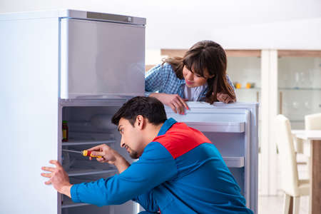 Man repairing fridge with customer Stock fotó