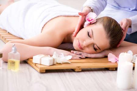 Young woman during spa procedure in salon Archivio Fotografico