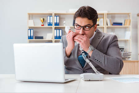 Businessman leaking confidential information over phone 스톡 콘텐츠