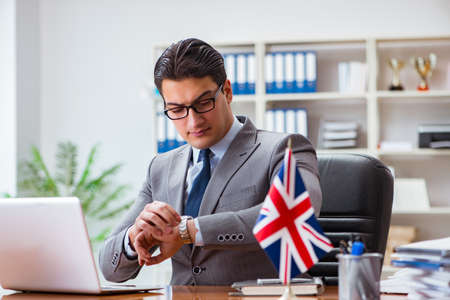 Businessman with British flag in the office