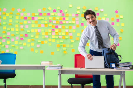 Man in the office with many conflicting priorities Stock Photo
