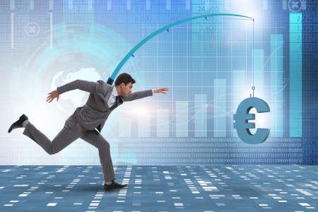 Businessman chasing money on fishing rod Reklamní fotografie