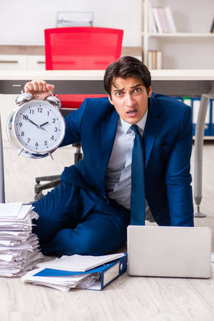 Tired exhausted businessman working overtime in office Stock Photo