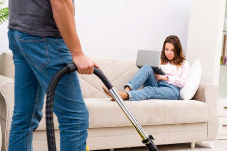 Young family doing cleaning at home