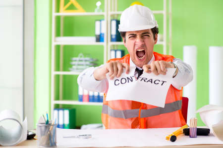 Angry construction supervisor cancelling contract