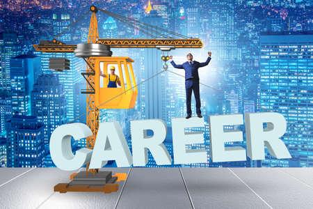Businessman in career progression concept with crane Banco de Imagens