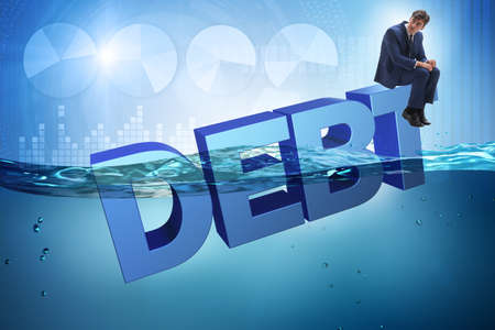 Businessman in debt business concept Banco de Imagens