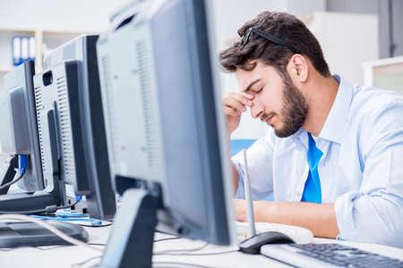 IT technician looking at IT equipment