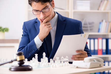 Young lawyer playing chess to train his court strategy and tactical