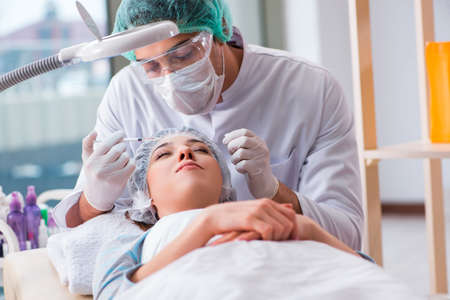 Woman visiting doctor for plastic surgery Stock Photo