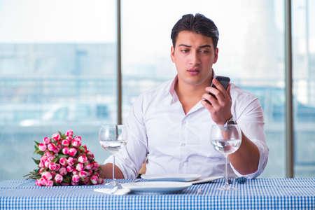 Handsome man alone in restaurant on date