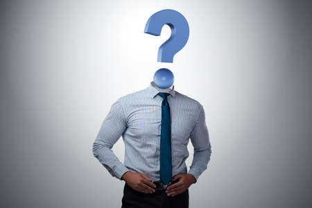 Businessman with question mark instead of his head Stock Photo