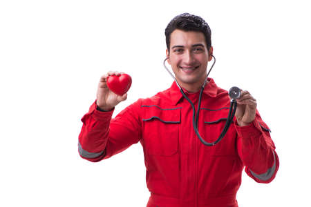 Young handsome man with stethoscope and heart  in red uniform is