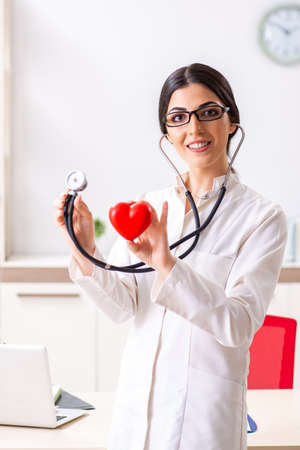 Young doctor in heart care concept Banco de Imagens