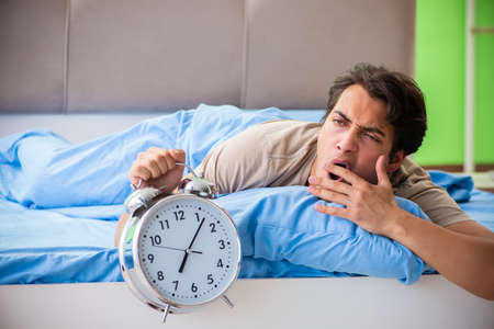 Man having trouble with his sleep Banque d'images
