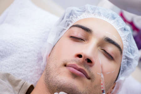 Man visiting doctor for plastic surgery Stock Photo