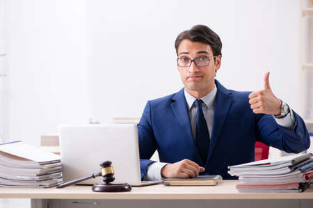 Young handsome judge working in court Stock Photo