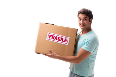 Young handsome man with fragile box ordered from Internet Stock Photo