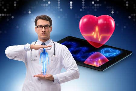Telemedicine concept with remote monitoring of heart condition Фото со стока